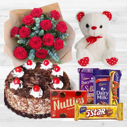 12 Red Roses with Cake, Cadburys and Teddy Bear to Hazira